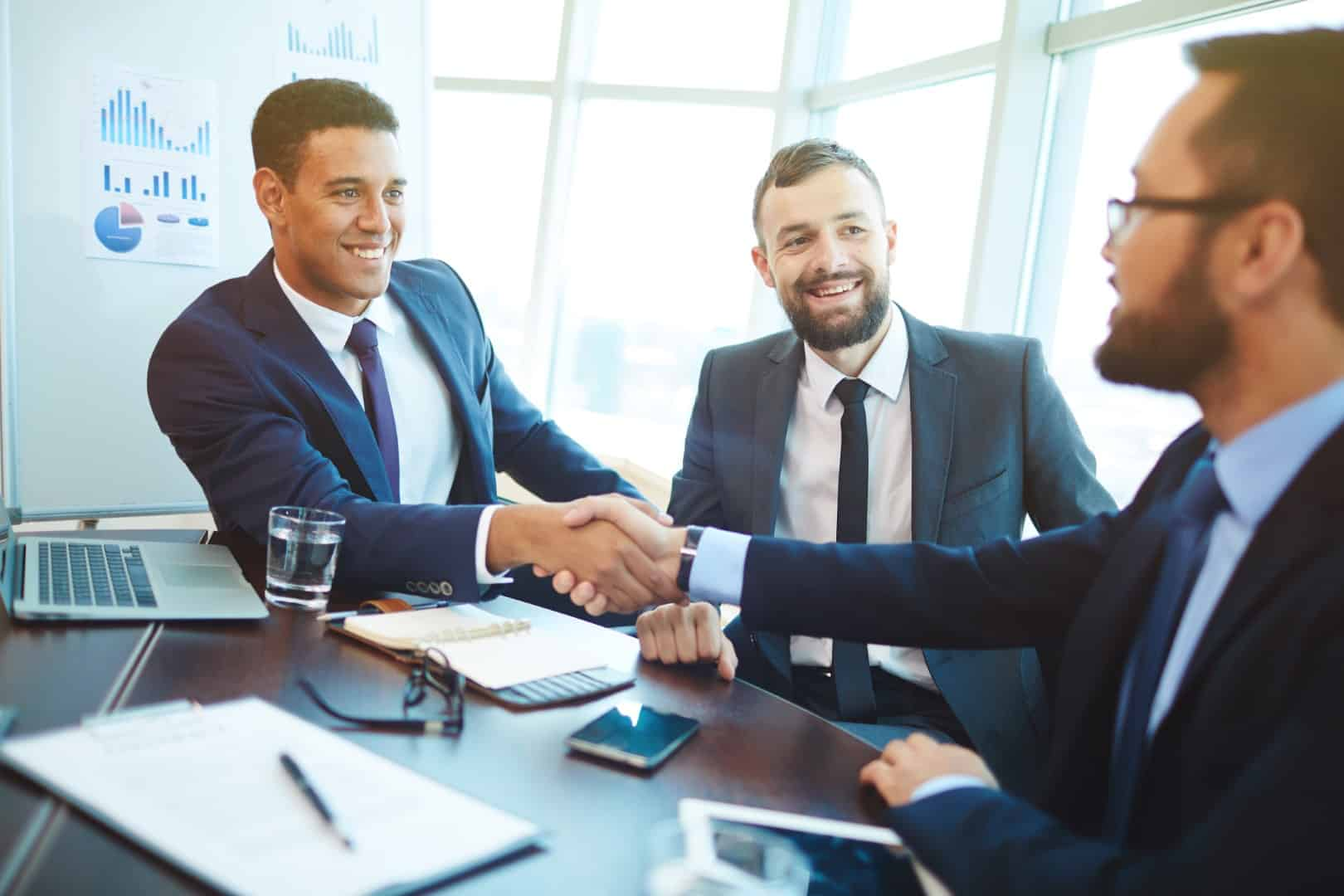 Agents shaking hands after a successful negoation.