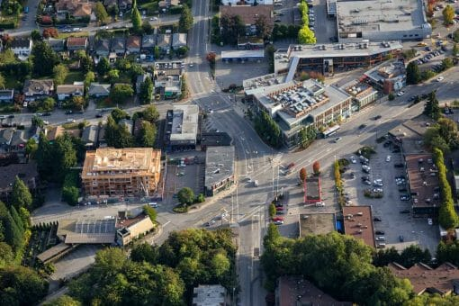 Aerial view of a shopping mall and residential neighbourhood in North Vancouver, BC.