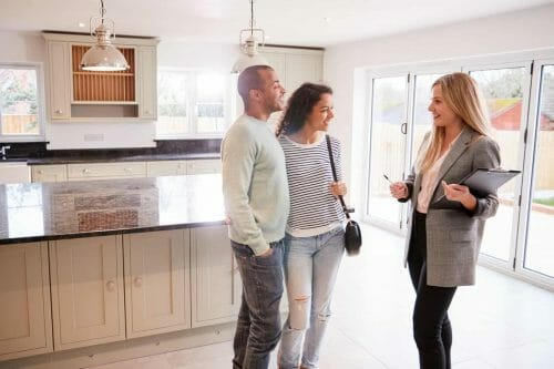 Real estate agent showing clients interested in buying a house.